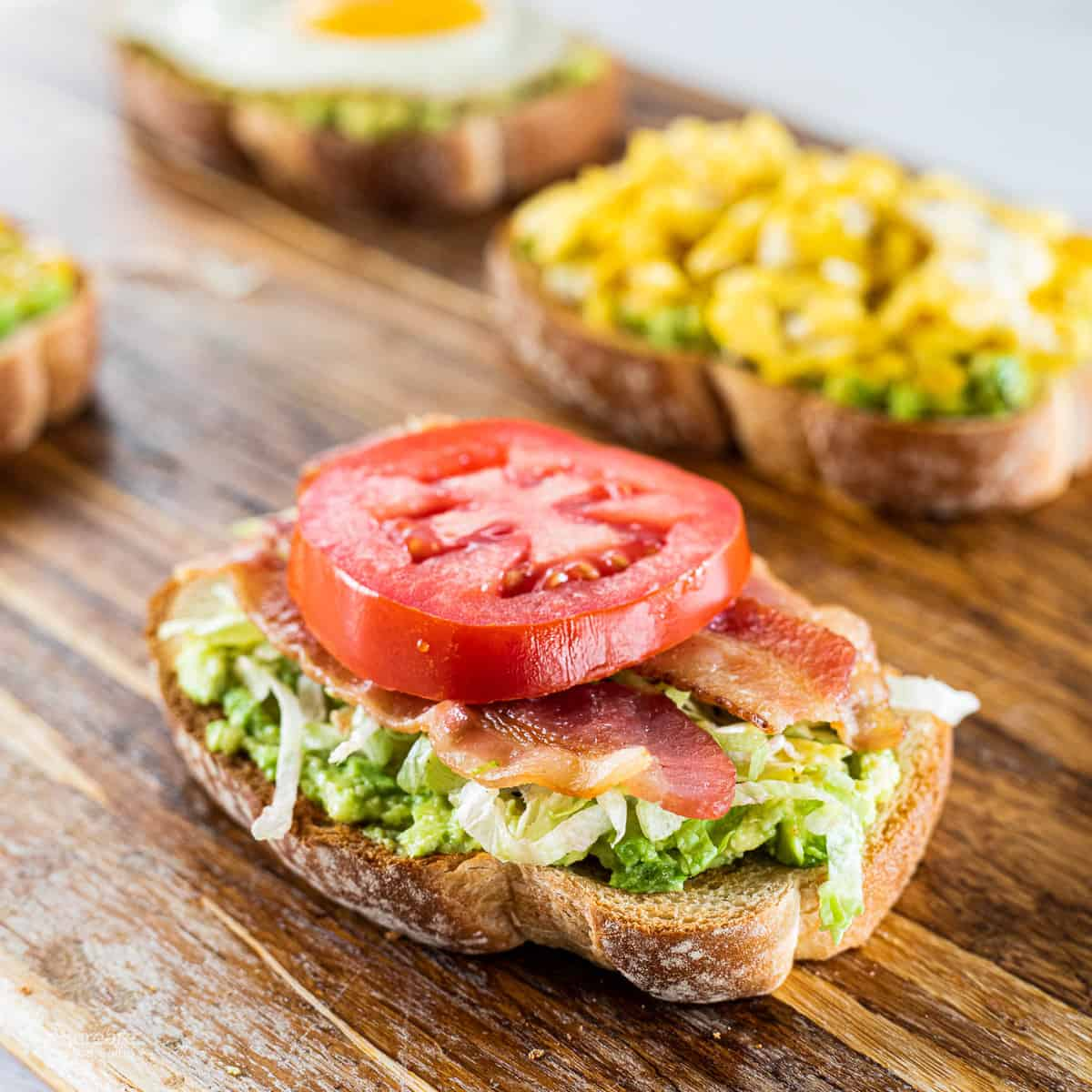 avocado toast with BLT on top