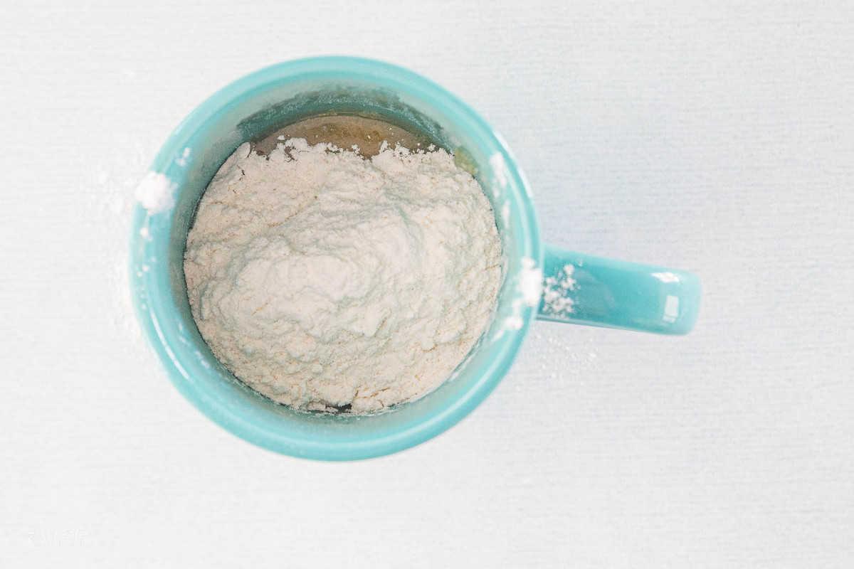flour in mug with an egg