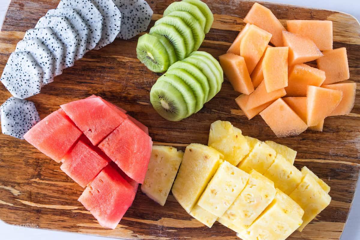 Sliced fruit on a cutting board