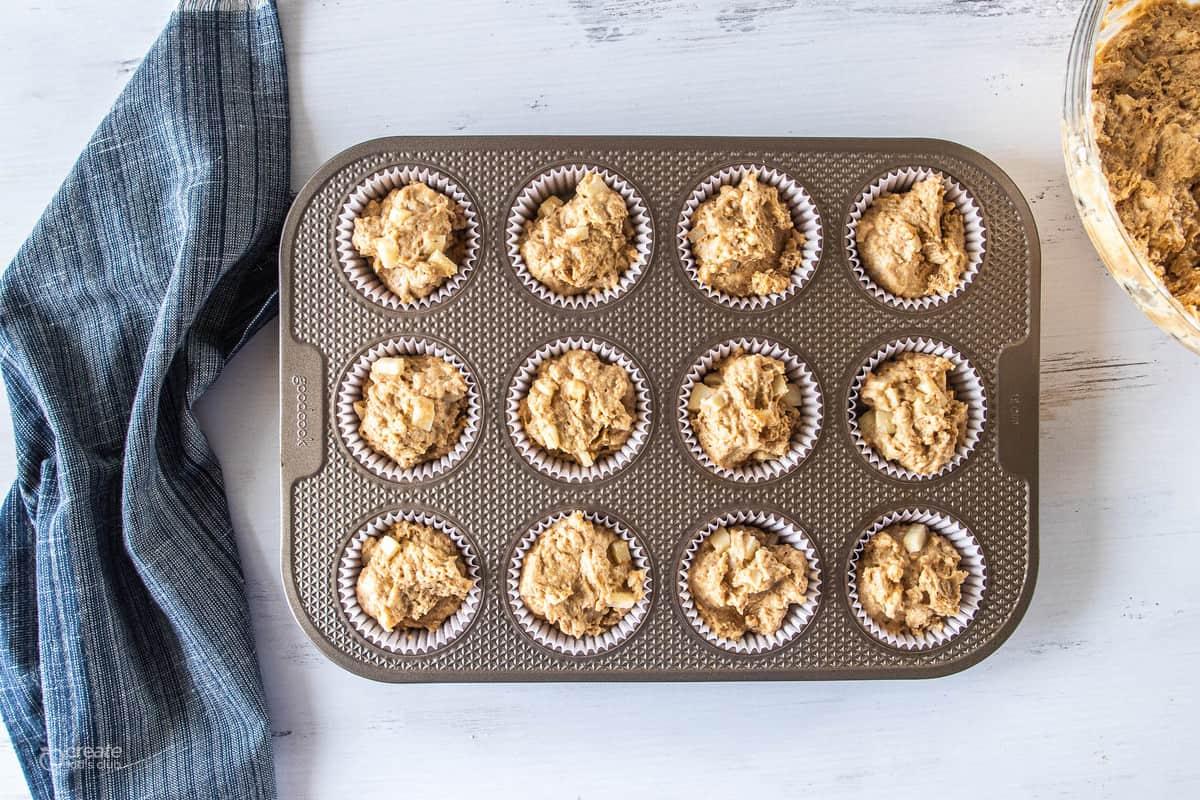 muffin batter in muffin tin