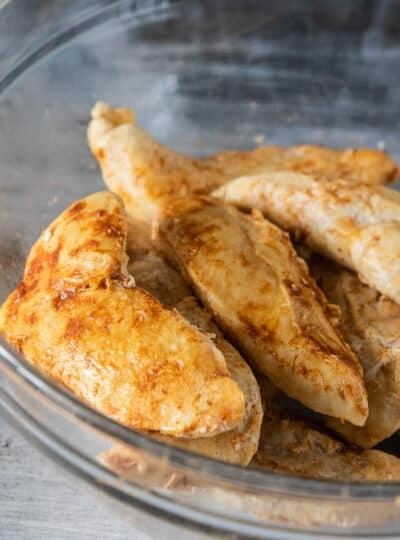 cooked chicken tenderloins in bowl