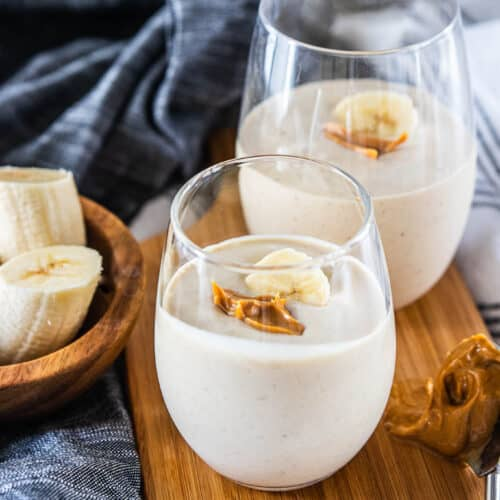 peanut butter banana smoothie in drinking glasses