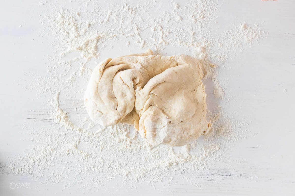 bread dough on floured surface