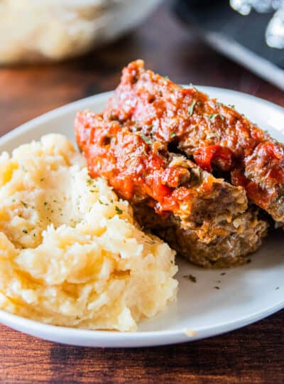 meatloaf on plate with mashed potatoes