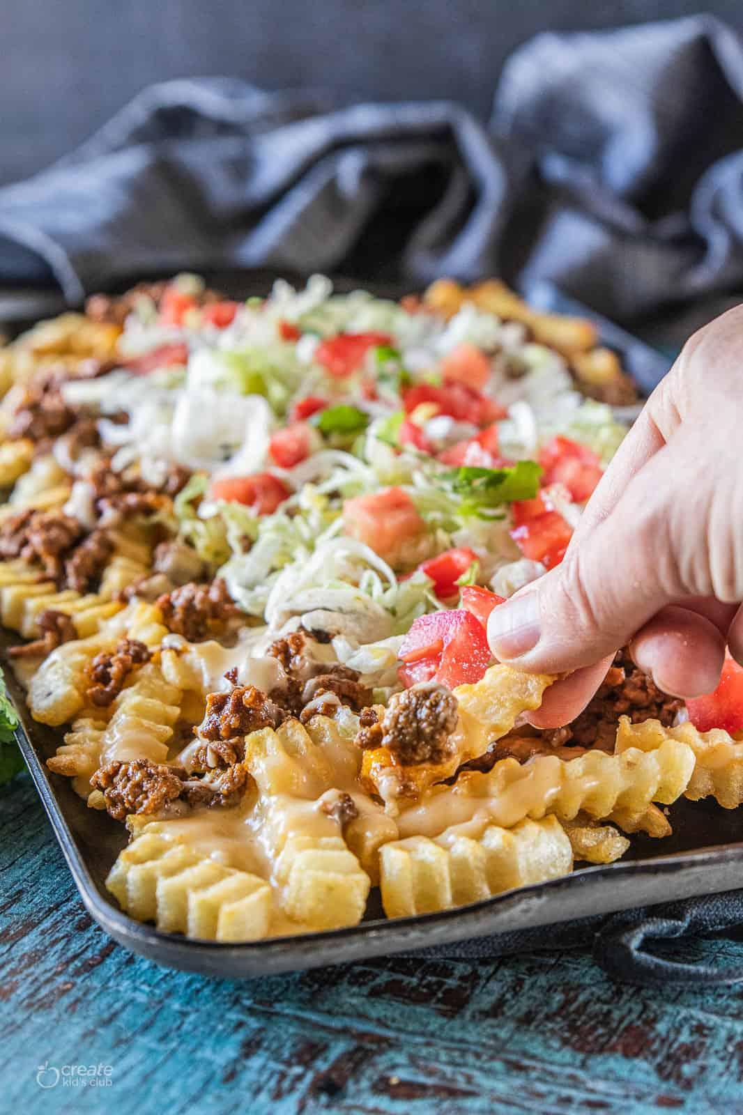 nacho fries on a baking dish
