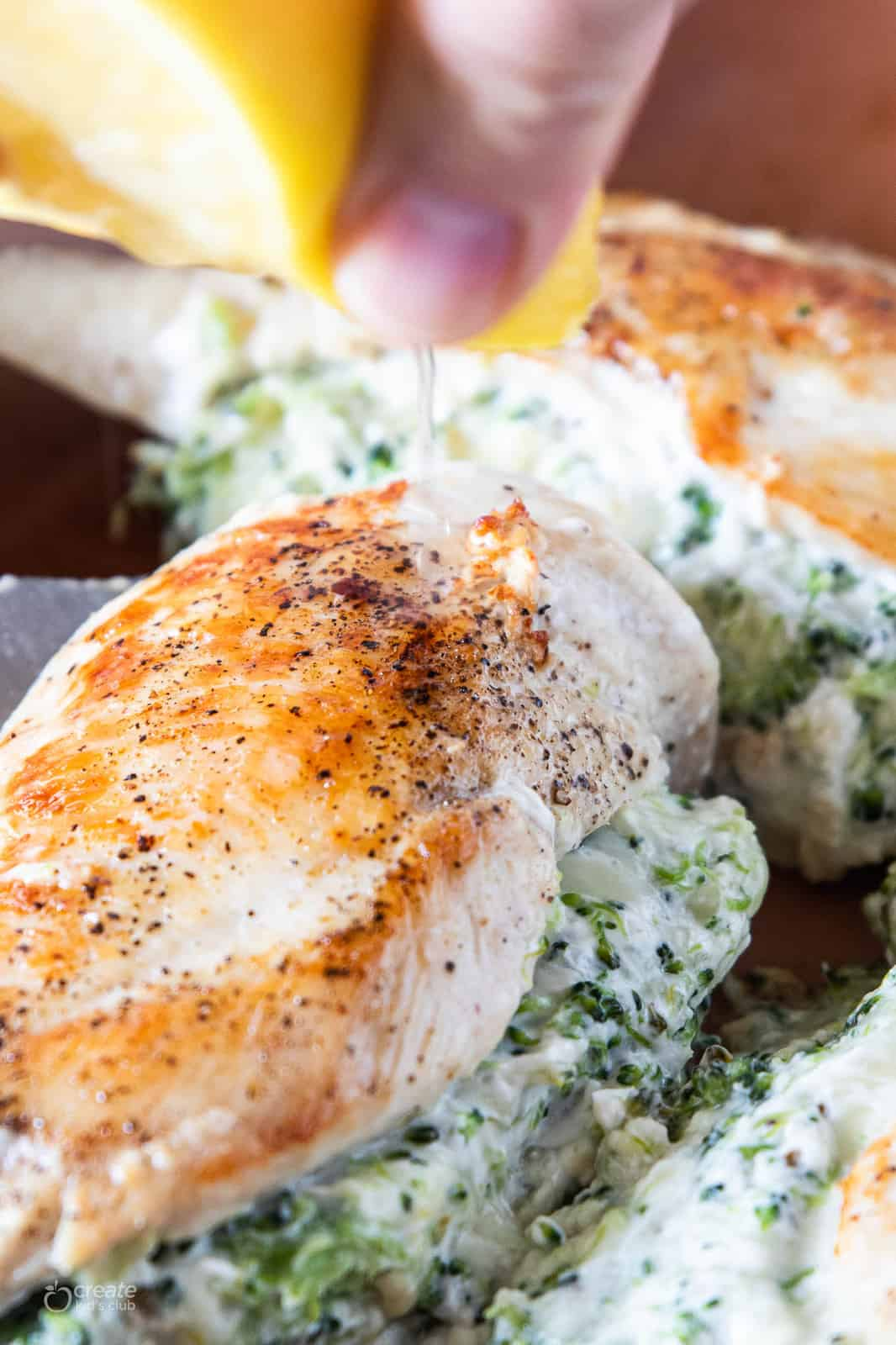 lemon squeezed over stuffed chicken breast
