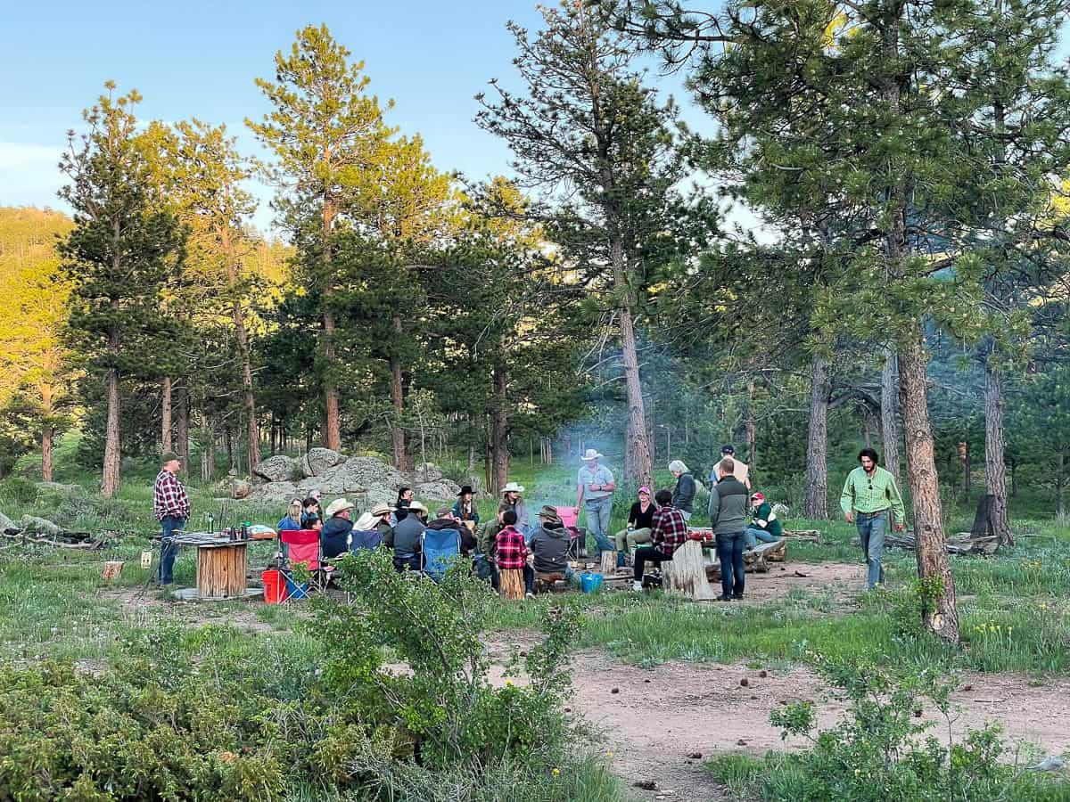 families gathering around campfire