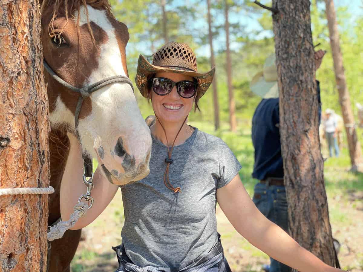 women leading a horse
