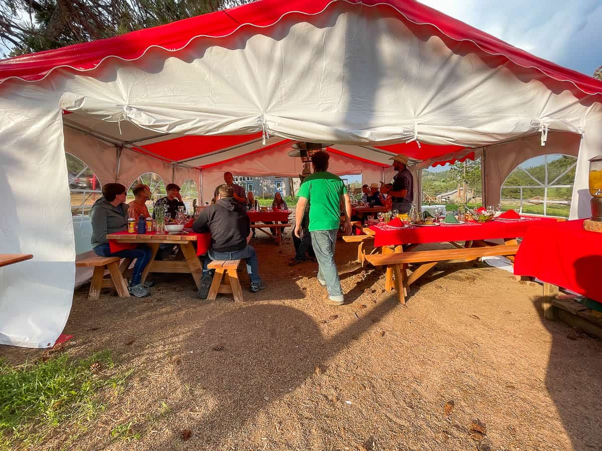 ranch guests dining in outdoor tent
