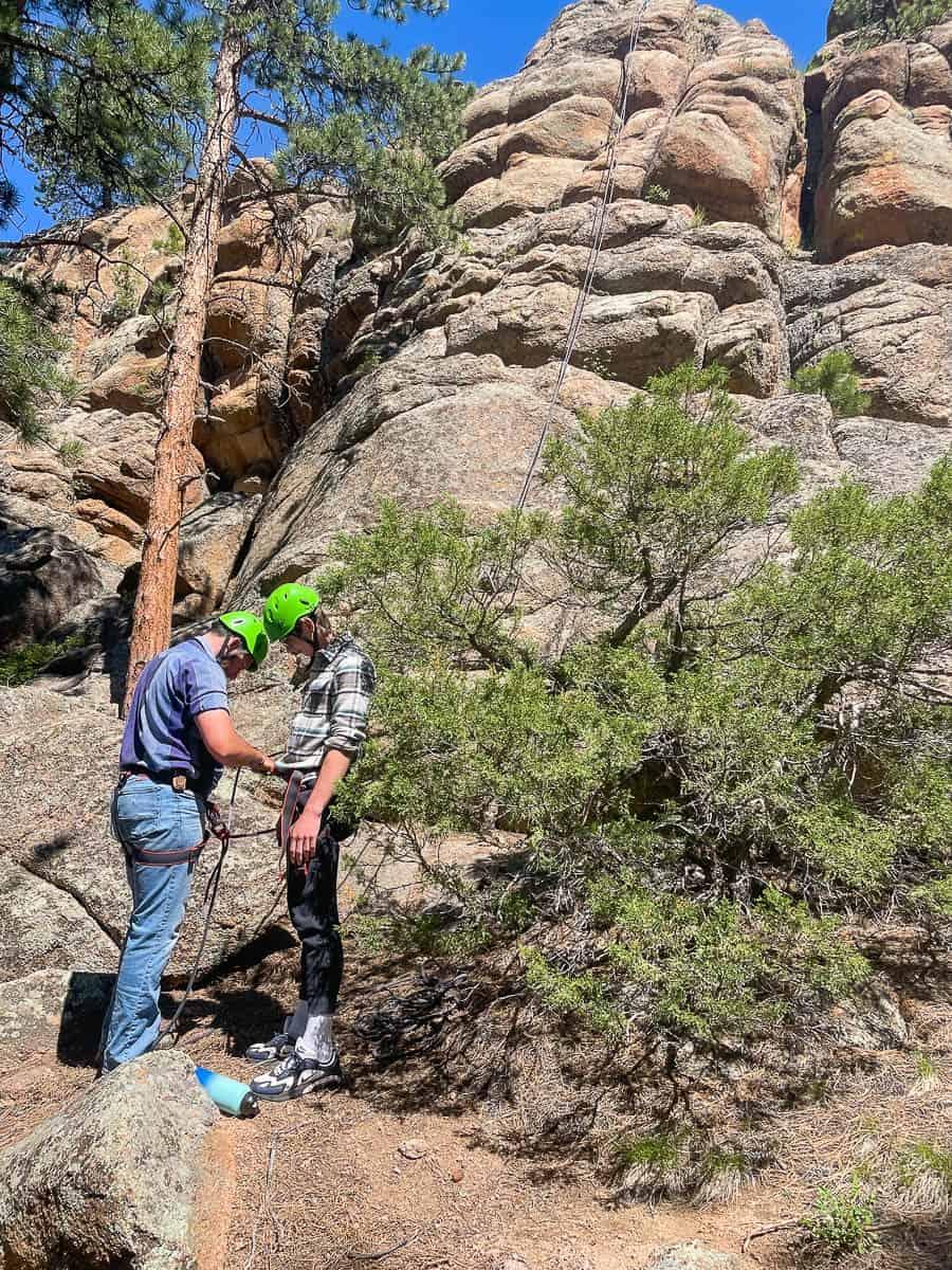 family climbing rocks in colorado