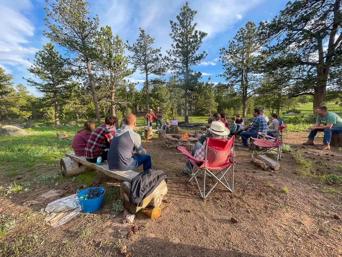 ranch guests gathered around a campfire