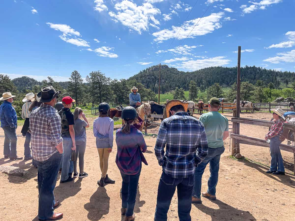 ranch guests at a horse riding lesson