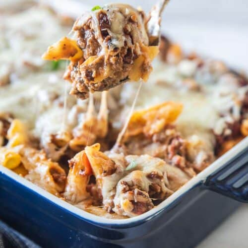 spoon scooping baked ziti with sausage