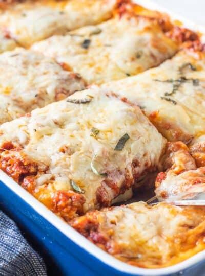 sliced lasagna in baking dish