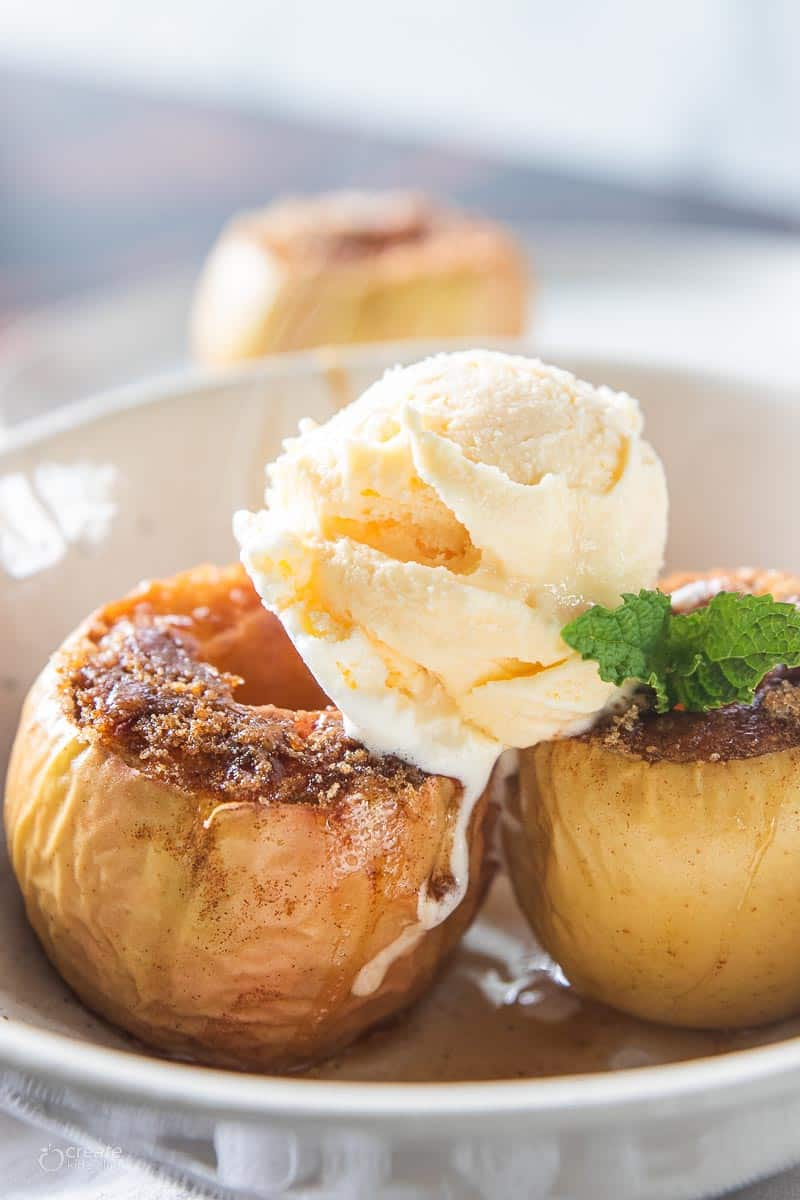 baked apples topped with scoop of vanilla ice cream