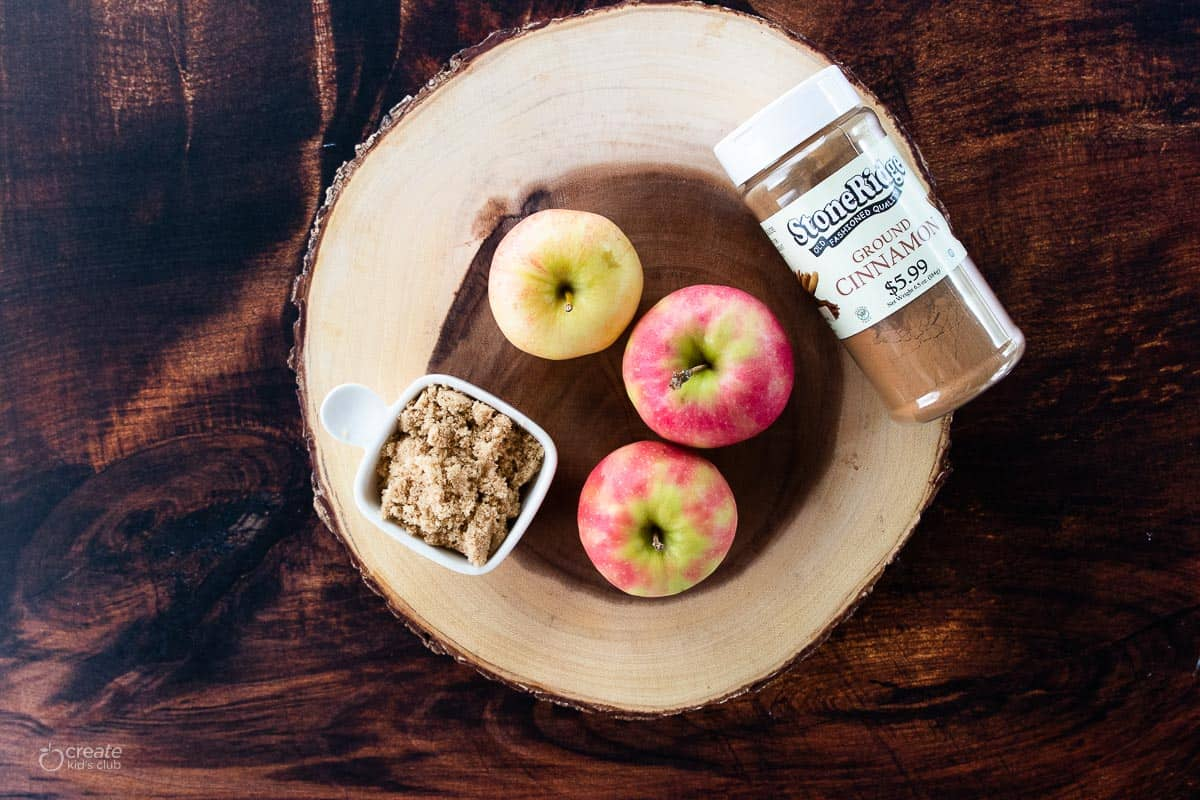 ingredients for air fryer baked apples on a wood slab