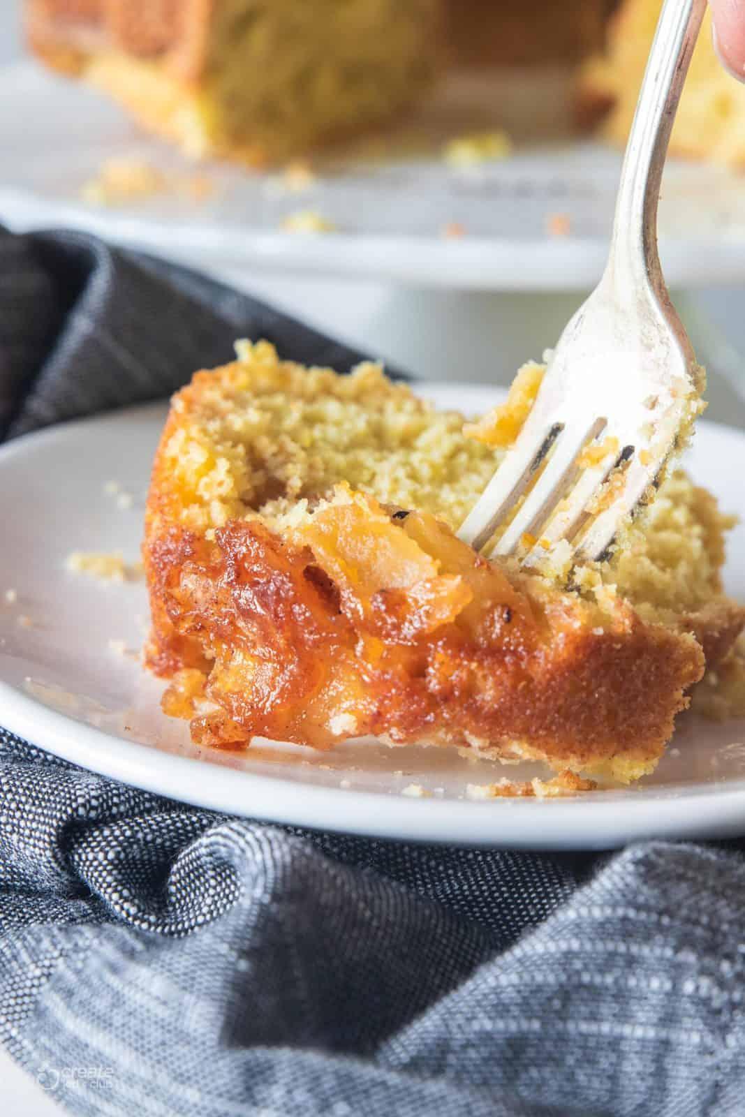 fork slicing into gluten free apple cake