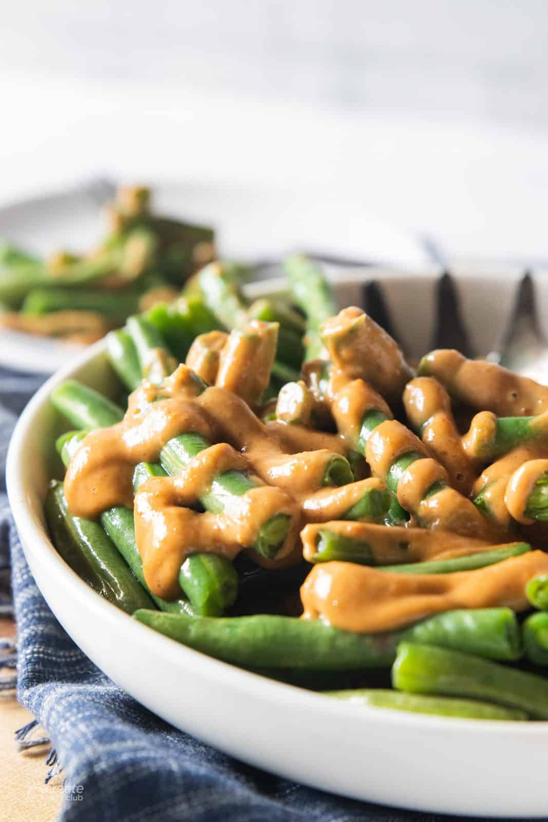 peanut sauce drizzled over green beans