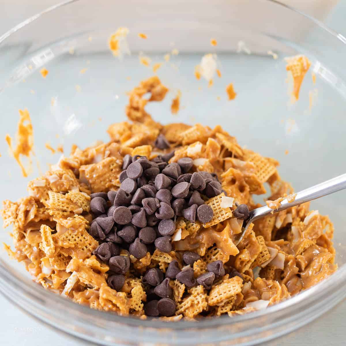 chocolate chips mixed into granola bar ingredients