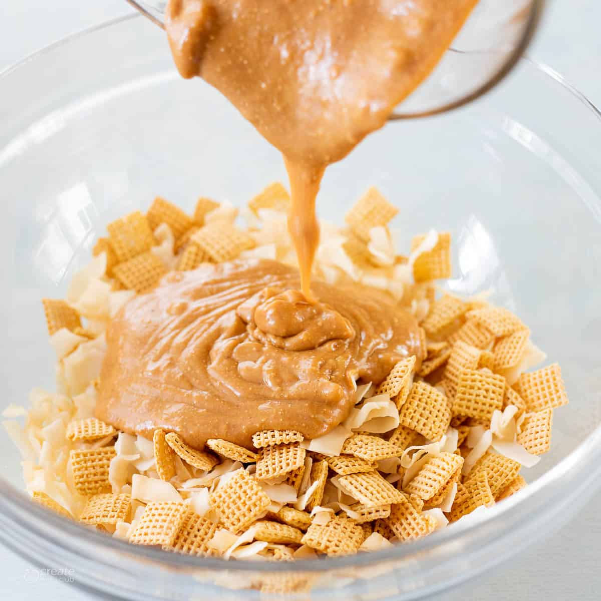 creamy peanut butter poured over Chex cereal in bowl