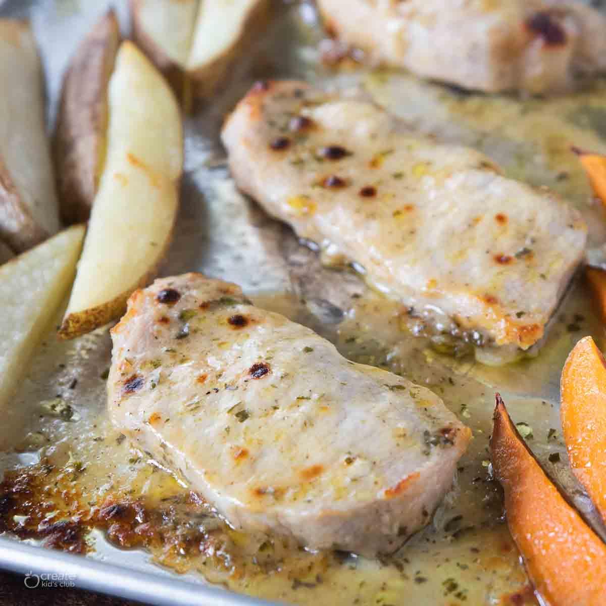marinated pork chop on sheet pan with potatoes
