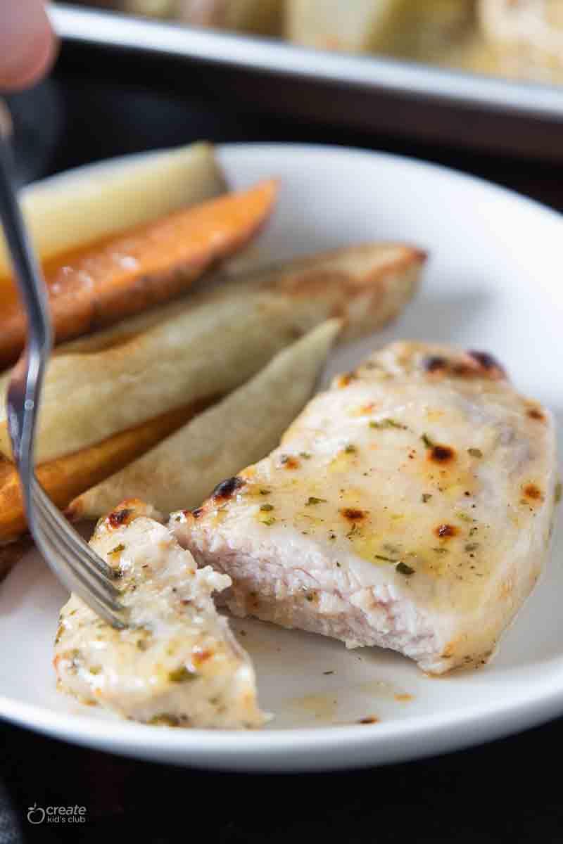 fork picking up bite of marinated pork chop