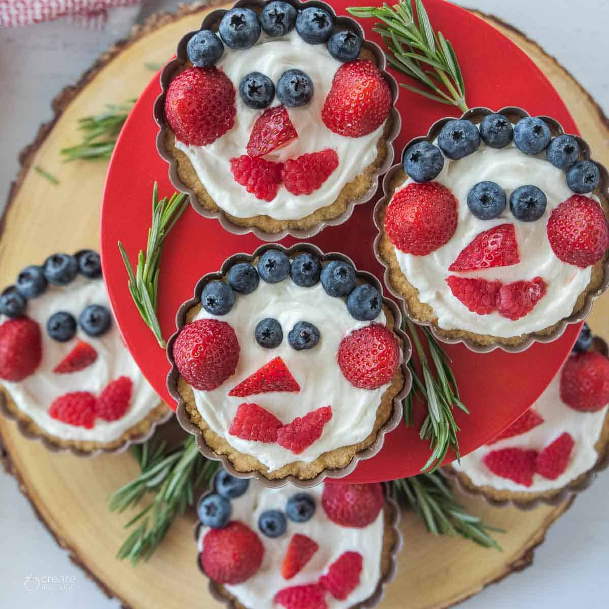 closeup view of Christmas fruit tarts stacked on stand
