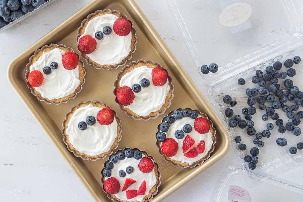 fresh berries added to fruit tarts