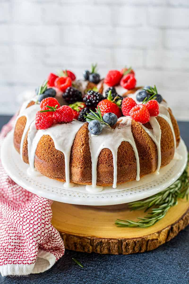 Bundt cake drizzled with icing and topped with berries