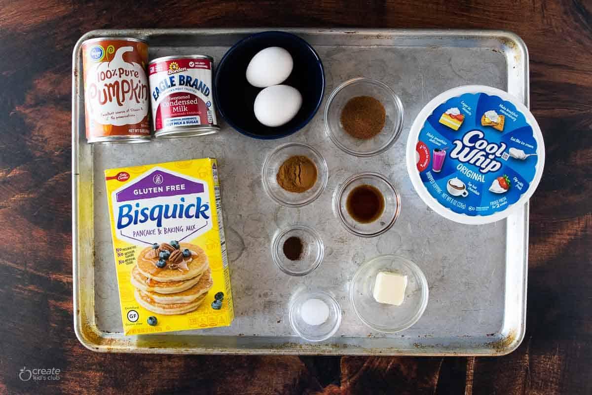 ingredients for gluten free pumpkin pie on baking sheet