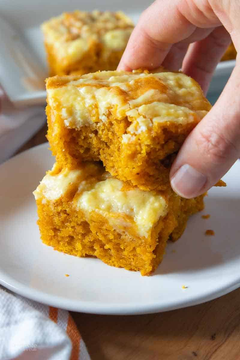 hand holding pumpkin bar with missing bite
