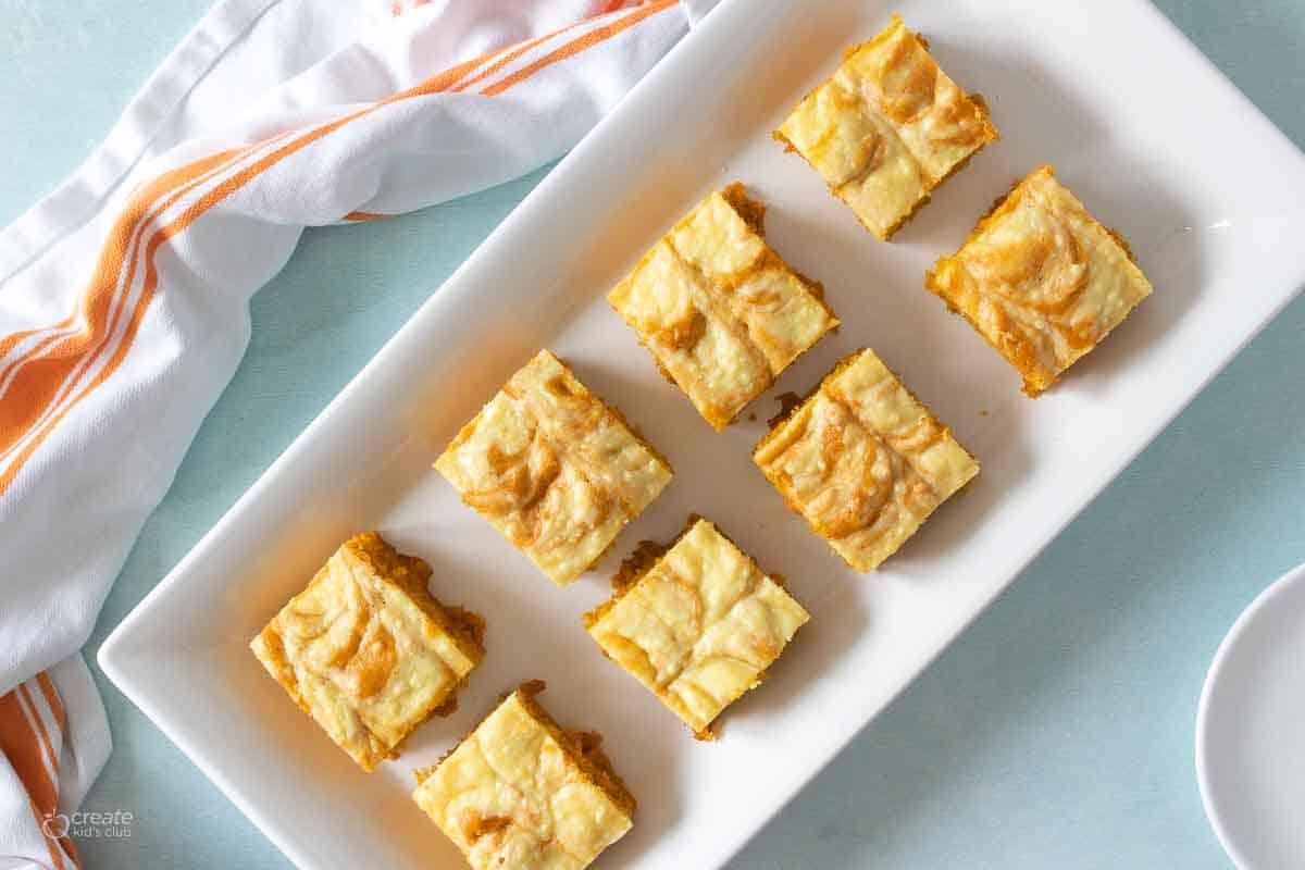 pumpkin bar squares on serving plate