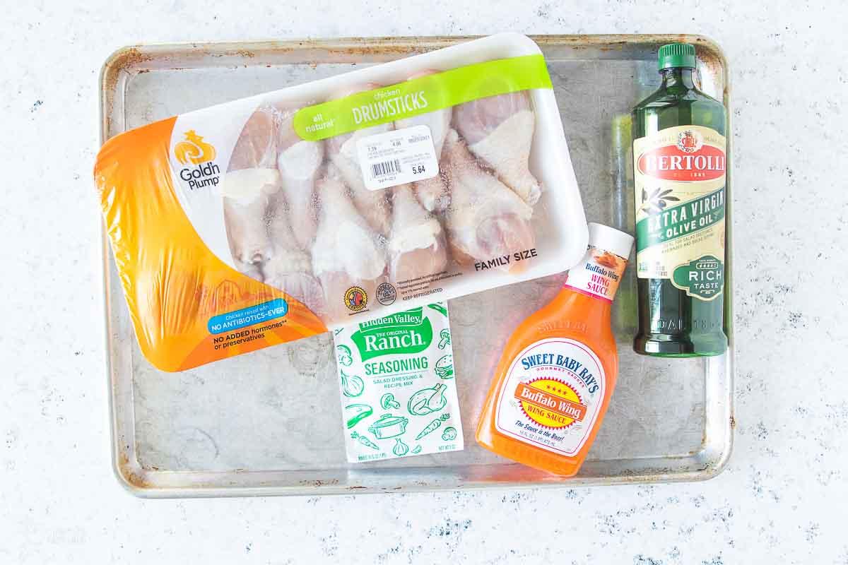 ingredients for buffalo chicken legs on baking sheet