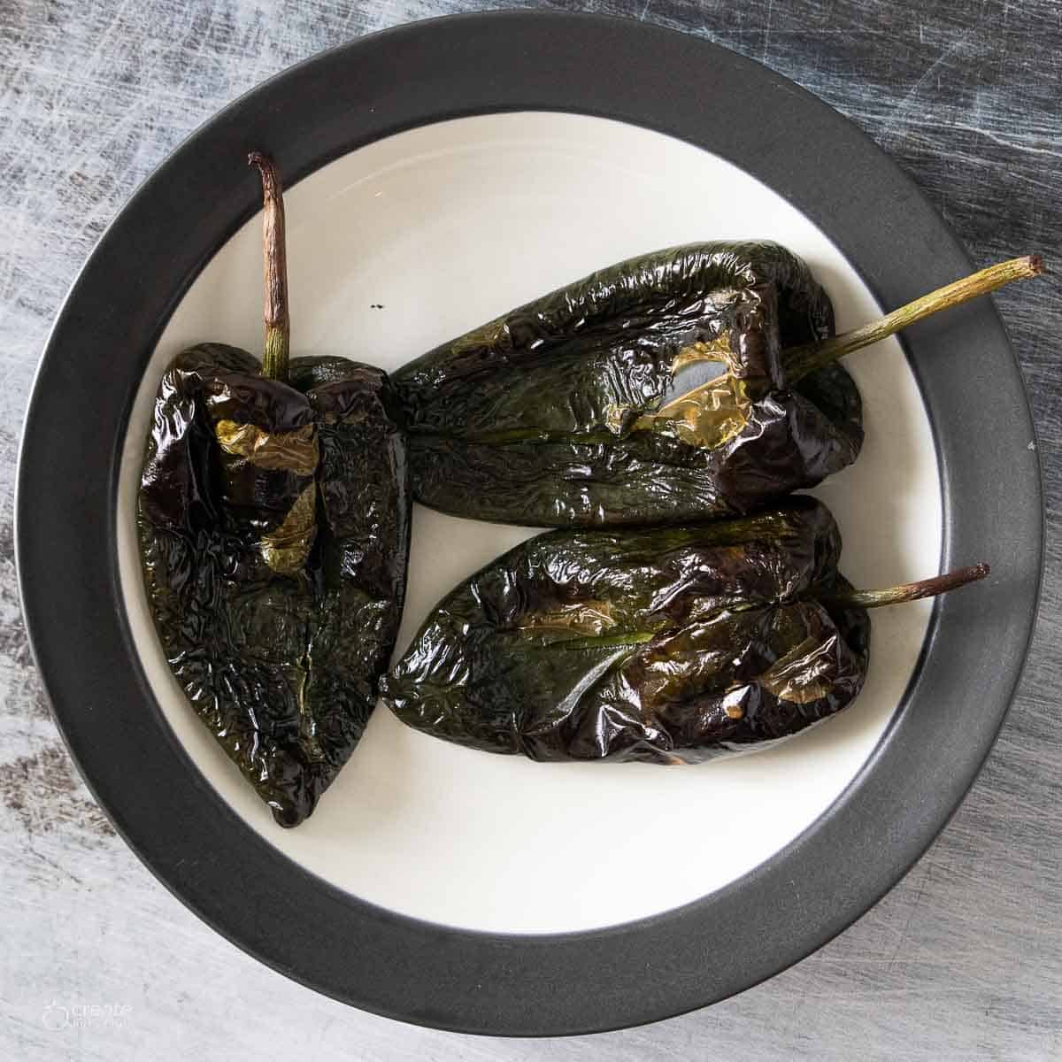 roasted poblano peppers on a plate