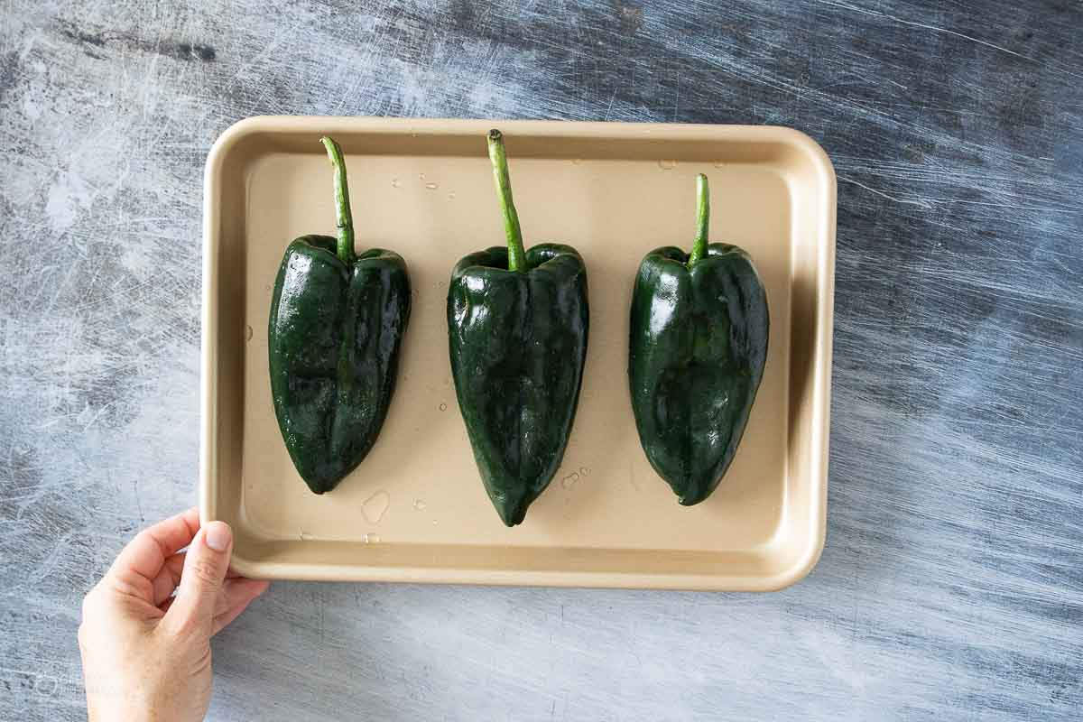 poblano peppers on a small sheet pan