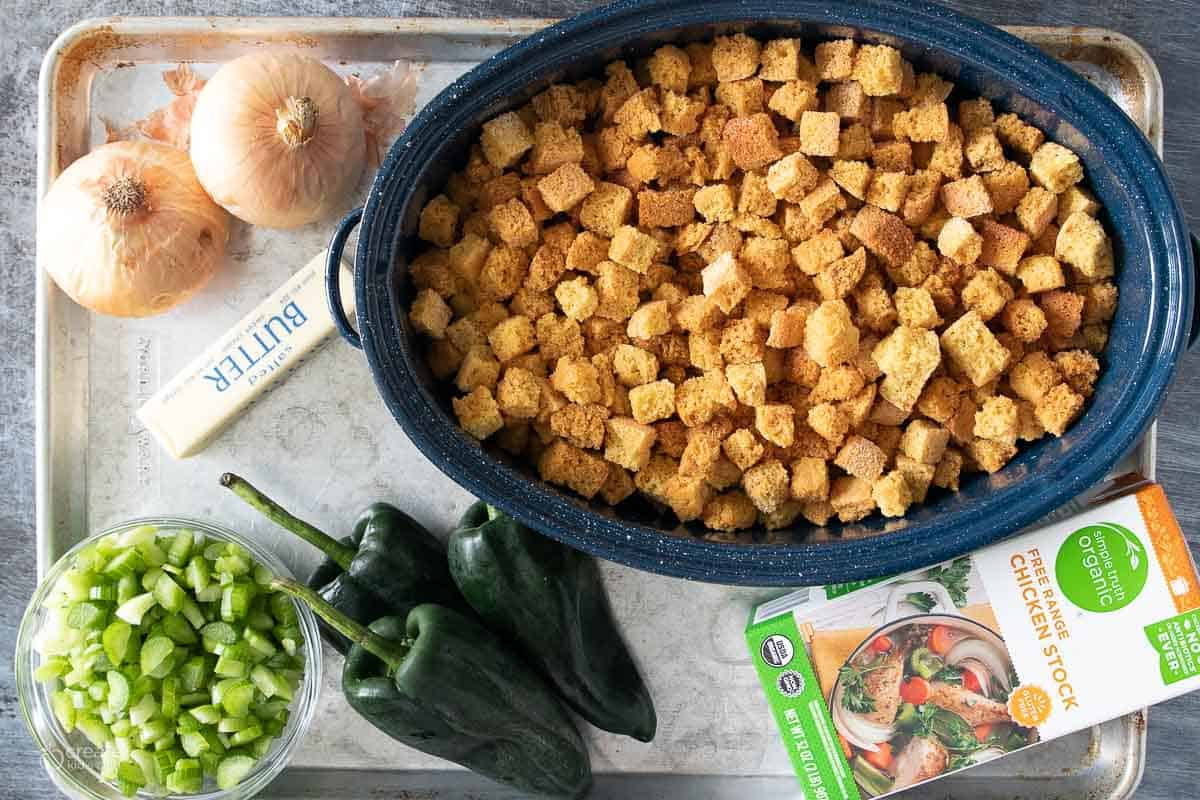 ingredients for gluten free cornbread stuffing on a sheet pan